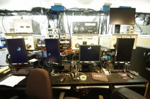 Four positions at the multi-op site, each with its own radio and computer screen.